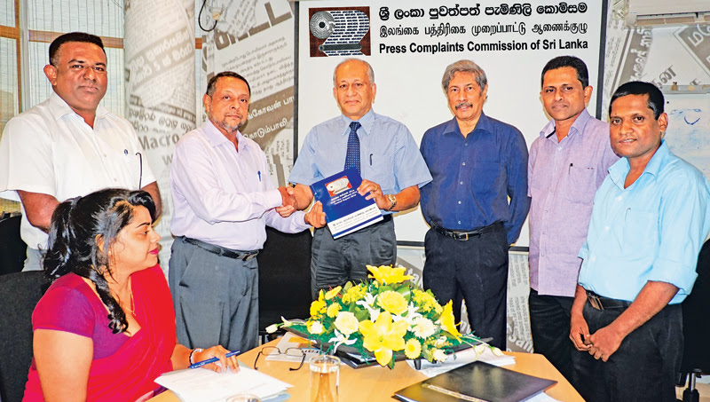 PCCSL CEO Sukumar Rockwood presents a copy of the Annual Report 2016 to Kumar Nadesan, Chairman, Board of Directors of the PCCSL. Also in the picture are Kamal Liyanarachchi, Complaints Officer, Sinhala Print (Extreme Left),Sinha Ratnatunga, Deputy Chairman of the PCCSL (Fourth from Left),Ananda Jayasekera and Duminda Sampath.Seated is Ms. Udara Weerasinghe, Executive Legal, Corporate Services (Private) Limited, Secretaries of the PCCSL.