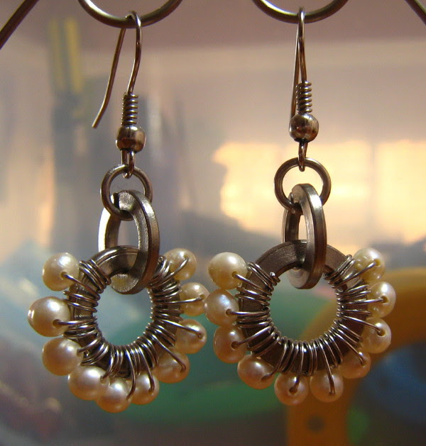 A pair of stainless steel washer wire wrapped with pearl for earrings