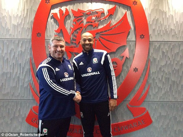 Thierry Henry (right) shakes hands with Welsh national team technical director Osian Roberts after his UEFA coaching course which the former Arsenal striker undertook in Wales