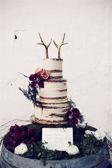 Picture Of a semi naked wedding cake with gilded antler