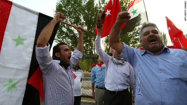 Members of the Syrian opposition protest against the Syrian regime outside the United Nations headquarters in Ankara, Turkey on September 19, 2011.