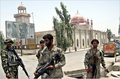 Afghan security officials on Thursday stood guard near a mosque in Kandahar where a suicide bomber detonated explosives.