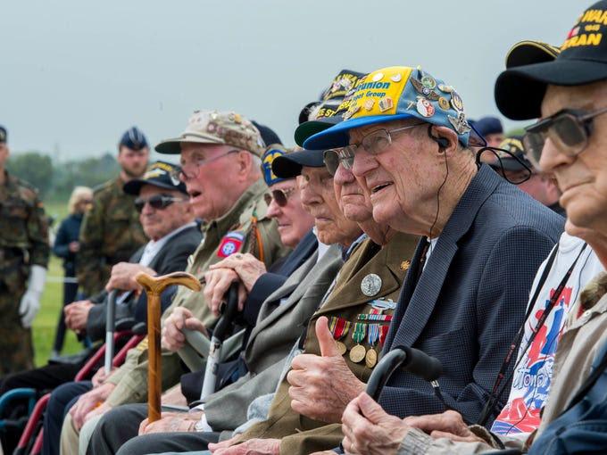 D-Day veterans listen during the Utah Beach Memorial