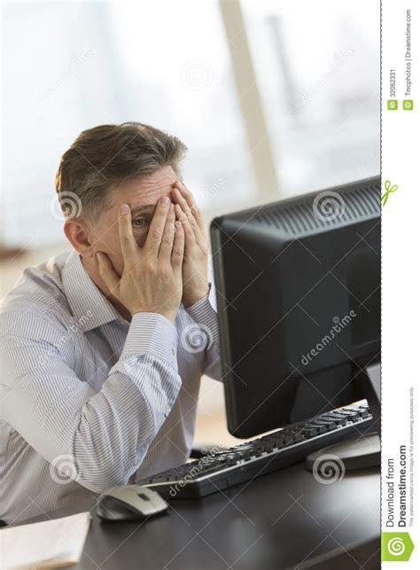 frustrated businessman  hands  face