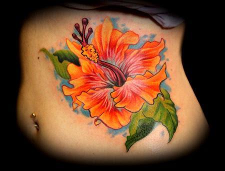 Hibiscus Flower On Ribs Tattoo Ideas Tattoomagz