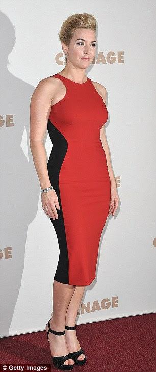 Ilusão de curvas: Kate Winslet varas para seu fiel vestido de vermelho e preto ilusão óptica para a estréia de Paris do seu novo filme Carnage anteriormente esta noite em Paris, França