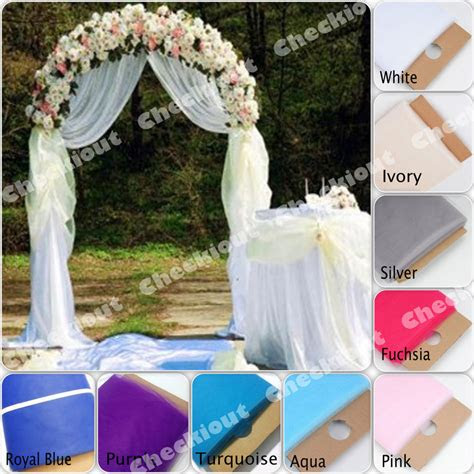 white metal arch  yards tulle wedding party