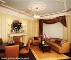 white ceiling design with POP and cream wall and brown sofa design ...