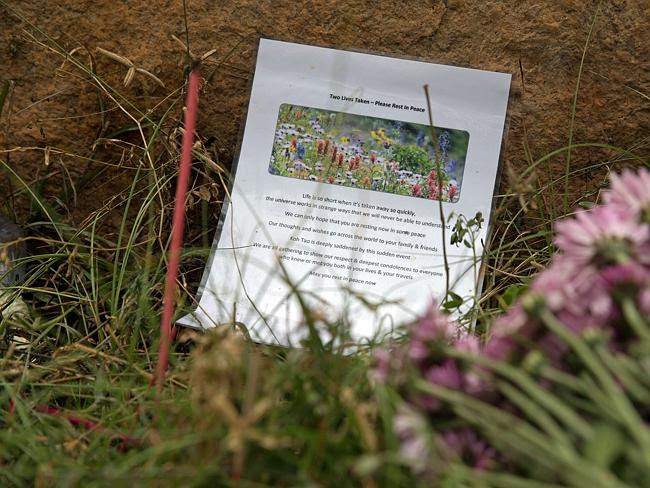 A tribute and flowers placed near the spot where two British backpackers were murdered.