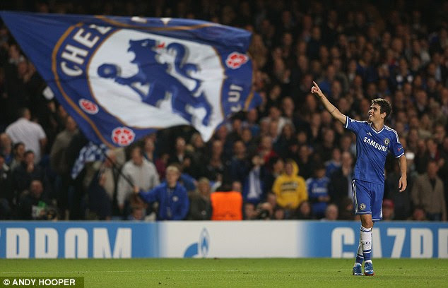 Flying the flag: Oscar celebrates after opening the scoring for Chelsea at the end of the first half