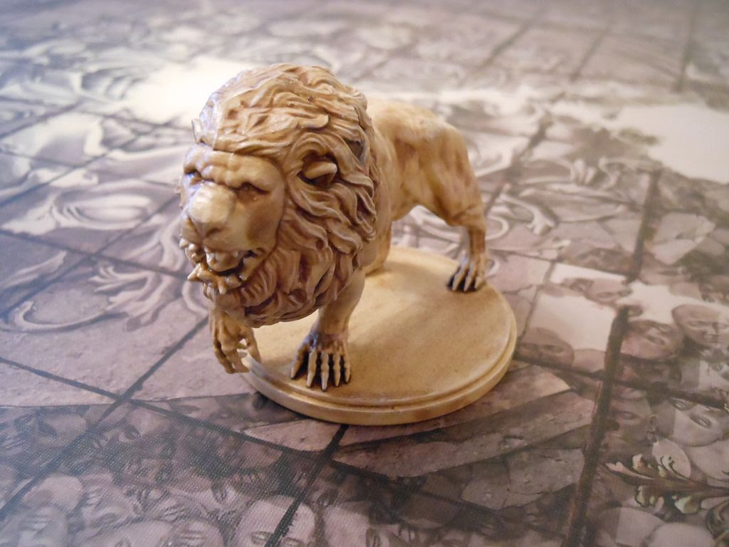 The lion from Kingdom Death: Monster, painted to look like bone.