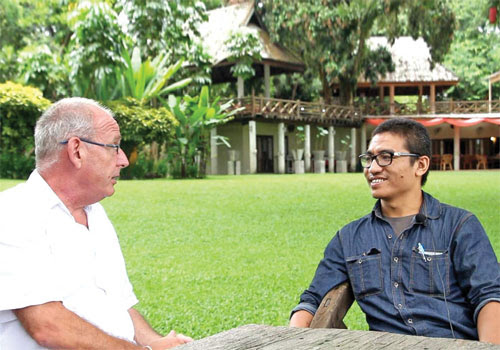Gambira (right) talks with therapist Dr Rory Magee at The Cabin in Chiang Mai, northern Thailand. Photo: Supplied