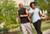 photo of couple walking in neighborthood