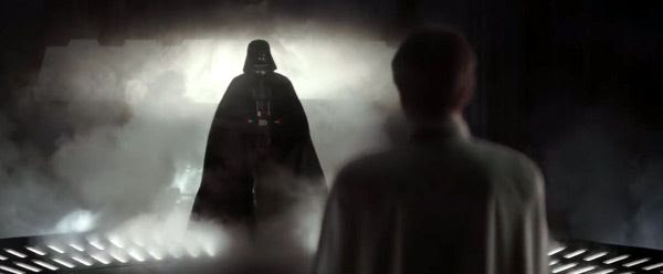 Darth Vader (once again voiced by James Earl Jones) approaches Director Krennic in ROGUE ONE: A STAR WARS STORY.