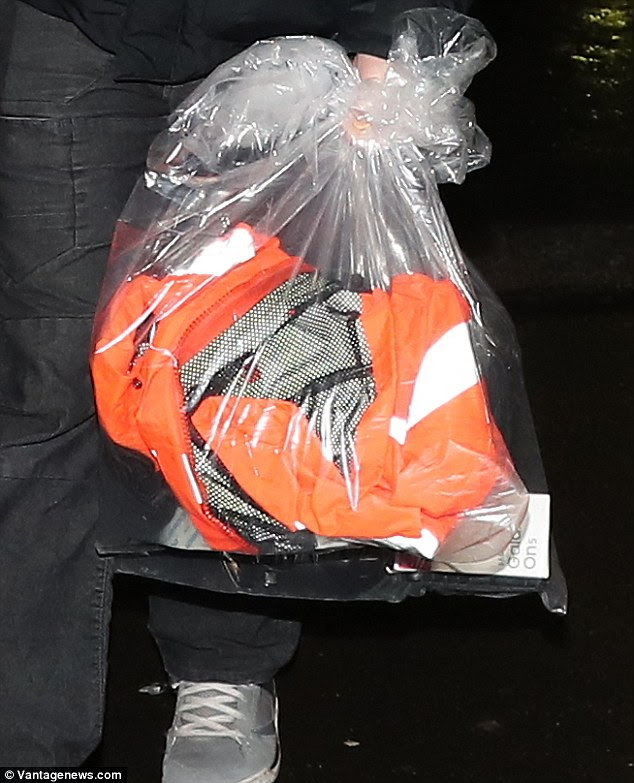 Bags from the raids were taken away by police yesterday and 17 people were arrested in total