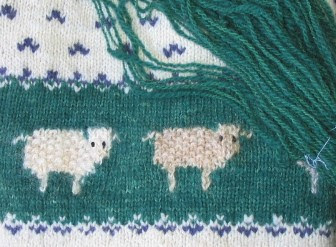 Comparison of the sweater & the new green yarn.