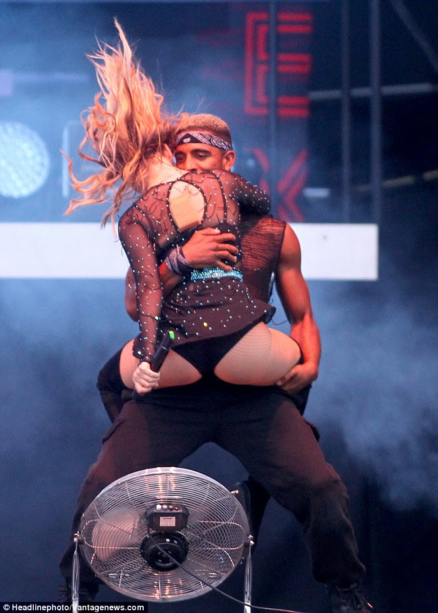 Up close and personal: The singer wrapped her legs around the male dancer, who supported her thighs