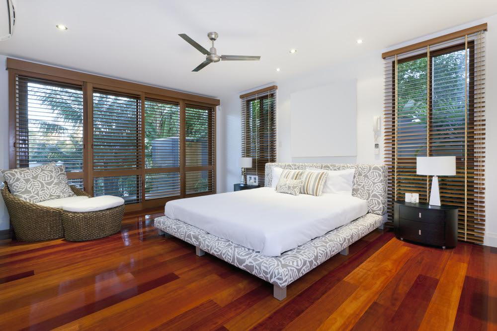 Modern master bedroom with wood floors - Interior Design Ideas