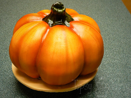 airbrushing fondant covered hand carved pumpkin cake