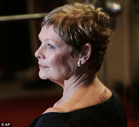 on the back of her neck - an eye-catching red crystal 007 tattoo.