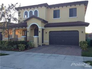 A 5-bedroom, 3-bath Miami home for sale at $285,000, the market median. Click the photo to go to the listing.