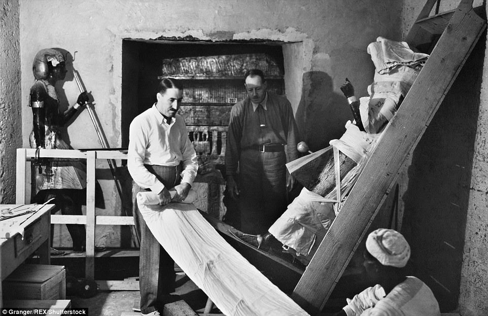 Carter was hired by English aristocrat Lord Carnarvon                to lead an excavation of Egyptian nobles' tombs in 1907.                Carter was on his last sponsored season when he made the                great discovery. Above, Carter wraps up one of the two                statues of King Tut for removal in 1923