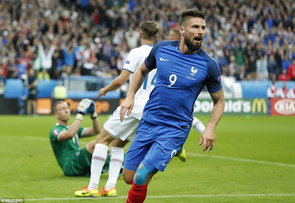 Olivier Giroud wheels away in celebration after giving France an early lead against Iceland during their Euro 2016 quarter-final