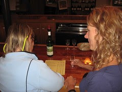 Sylvia and Laura check the wine line