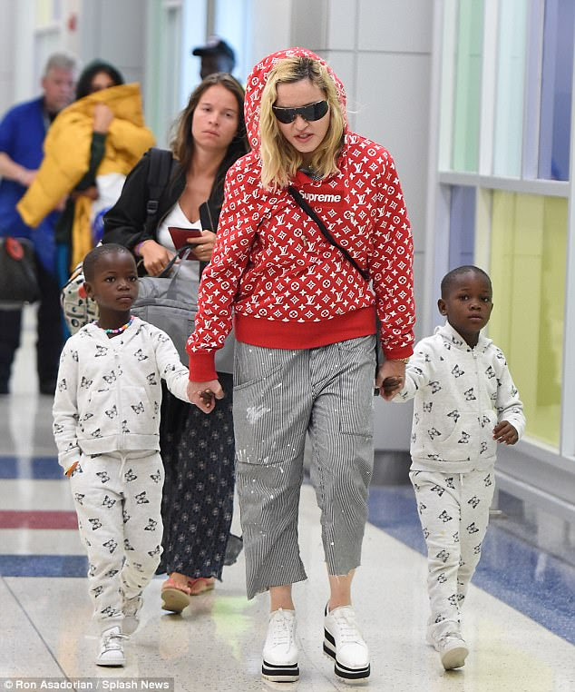 Jetlag: Madonna opted for comfort over style for her 10-hour flight back to New York's JFK Airport on Sunday with her family following her lavish 59th birthday celebration in Italy