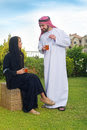 Arabian couple relaxing & drinking tea Royalty Free Stock Photo