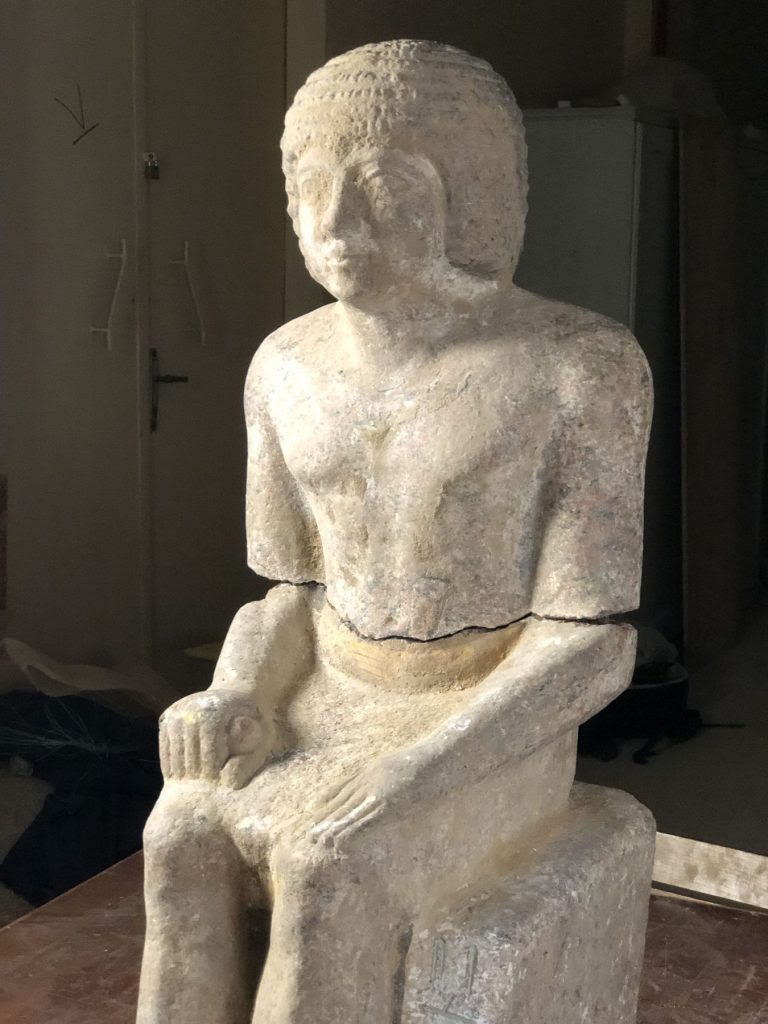 The large granite statue of Kaires greets excavators in            his burial chamber at Abusir (photo: Czech Institute of            Egyptology)