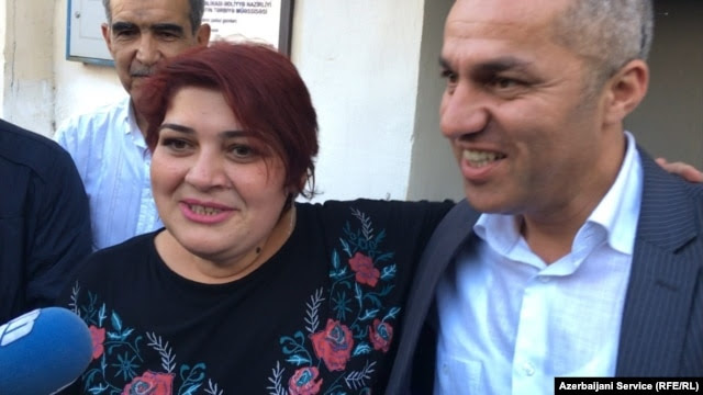 Khadija Ismayilova (left) talks to reporters upon her release from prison on May 25.