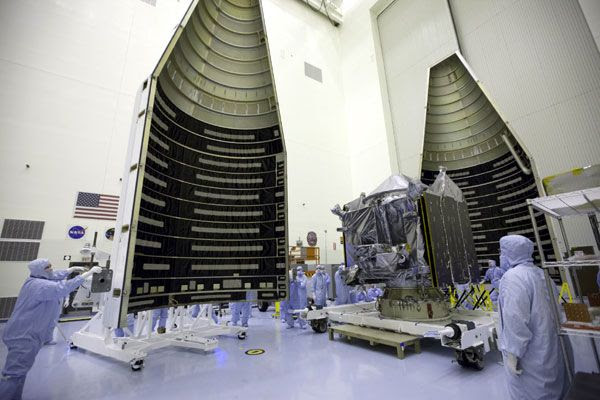 At NASA's Kennedy Space Center in Florida, the MAVEN spacecraft is about to be encapsulated within its Atlas V payload fairing...on November 2, 2013.