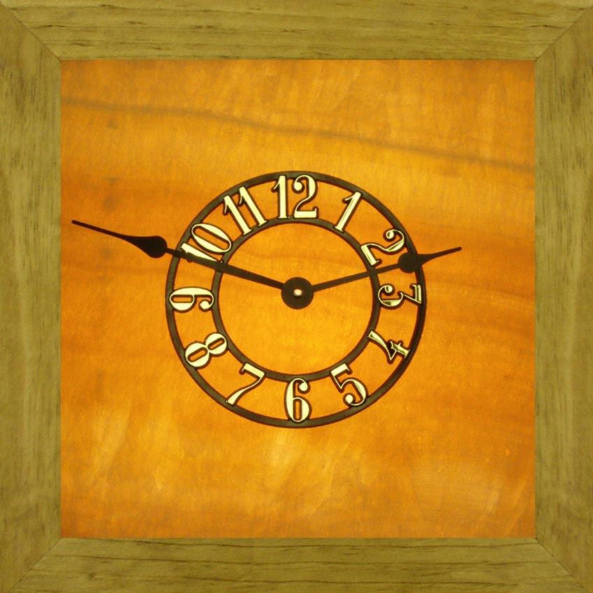 http://pebblez.com/pictures/stone-clocks/lighted/honey-clocks-3.jpg
