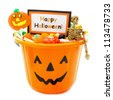 Halloween candy holder full of candy with Happy Halloween tag over white - stock photo