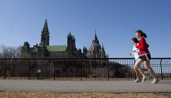 Joggers make their way through Major's Hill Park in downtown Ottawa on Wednesday, when temperatures hit a high of 16 C.
