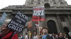 Demonstrators march past the Bank of England during an anti-austerity protest in central London