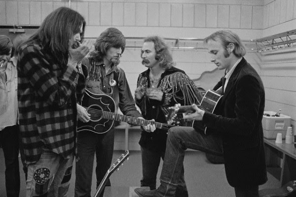 July 12th, 1970-- Crosby, Stills, Nash & Young rehearse backstage before a concert. -- Image by © Henry Diltz