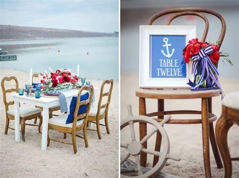 Nautical wedding reception table setting on the beach