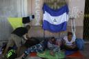 In migrant caravan, a Nicaraguan family flees persecution