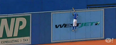 Rajai Davis steals a home run by leaping above a 10-foot wall. (via Yahoo! Sports Minute)