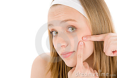 Royalty Free Stock Images: Acne facial care teenager woman squeezing pimple. Image: 19406999