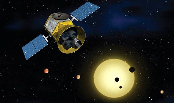 An artist's concept of NASA's Transiting Exoplanet Survey Satellite (TESS) hunting for alien worlds.