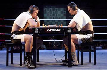 (Left to Right) Russian Nikolay Sazhin 'The Chairman' in action with German Frank Stoldt during their light heavyweight world championship title in chess boxing in Berlin Germany
