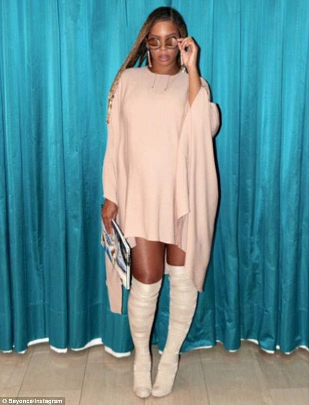 What a beauty: She chose a light pink high-neck number, with an oversized fit and an asymmetrical hemline