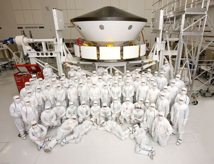 70 members of the Mars Science Laboratory's (MSL) flight team pose for a group photo inside an assembly building at NASA's Jet Propulsion Laboratory in California.