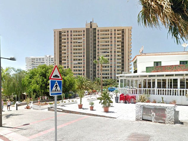 A British tourist has been arrested in Tenerife after his girlfriend fell to her death from their high-rise holiday apartment in this block,Apartments Paraiso del Sur, in the resort of Adele