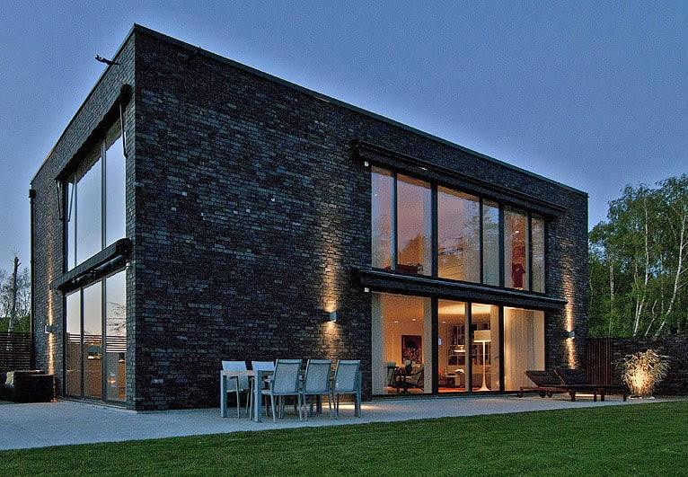 Black brick villa with chic Scandinavian charm - 1 Kind Design