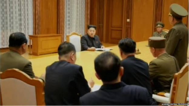 Screen grabs of Kim Jong-un attending the emergency expanded meeting of central military commission on the night of 20 August 2015.