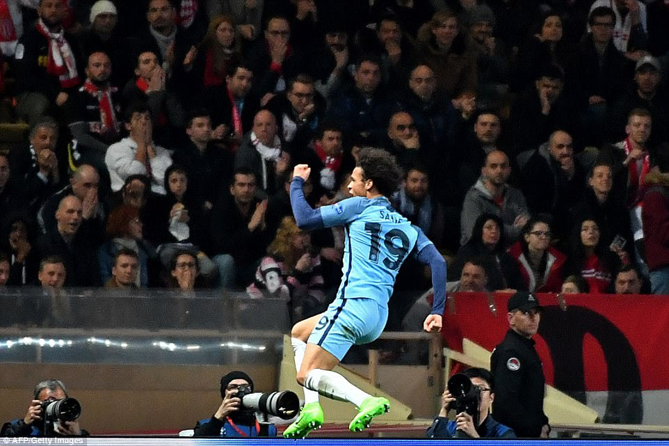 Sane leaps into the air as Monaco fans watch on - at that point, the English side were heading through to the last eight